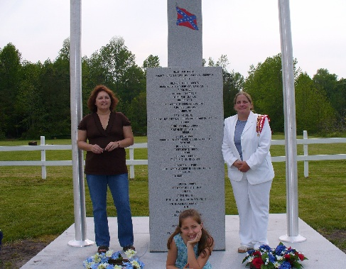 UDC Caleb Ross chapter president Joyce Zoch and member Laura Wilson stand beside the Delaware Confederate Monument after the unveiling event on May 12th, 2007.