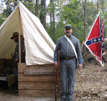 Commander John Zoch poses for picture in the Civil War camp, at the final Pepperbox Fall Harvest